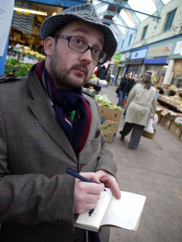Dan caught in the act of drawing in Brixton Arcade